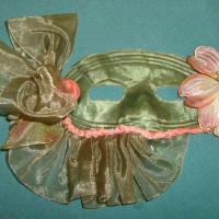 Green satine & buckram domino mask with ribbon & silk painted flowers. HandSewn $45